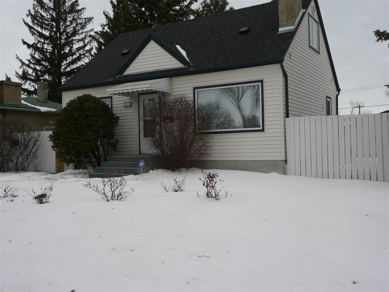 This renovated semi bungalow is on a 55x150 lot with oversized (24x26) dbl garage. Renovations with this owner include windows ,roof, bathrooms, insulation, siding, flooring, kitchen ,chimney ,retaining wall, plumbing, garage doors and gas lines, electrical, eaves and and hot water tank. Move in ready. What it lacks in size it makes up for it in quality. Open dining and family room with gas fire place. Updated alarm system. Large deck with gas line for BBQ.  Main floor has a den and 3 pce bath. There is a large 4 pce bath in basement wit heated floors. Kitchen has ceramic floors that are heated as well. Large family room in basement and a storage area in utility room. The HTW and water meter have been upgraded in 2016. Huge lot could be subdivided. Lots of newer infill homes in the area. Close to all amenities and Highland Golf course and Eastglen pool.