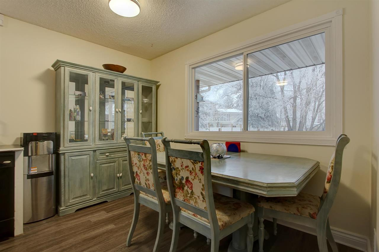The dining area will hold both a table and china cabinet as shown here. The large window allows you to watch the kids play in the yard from the kitchen.