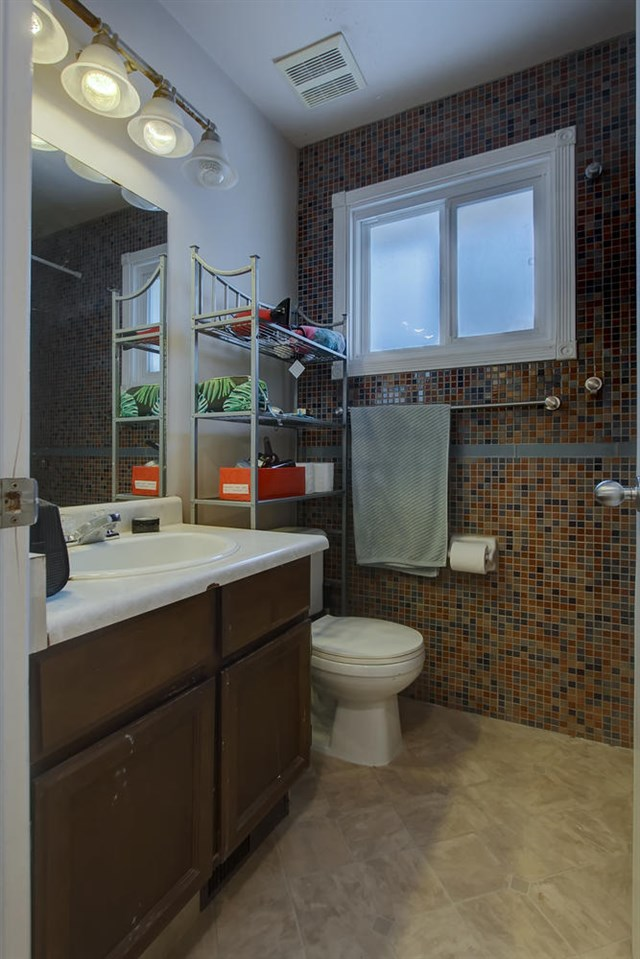 The handy powder room is right by the back door.