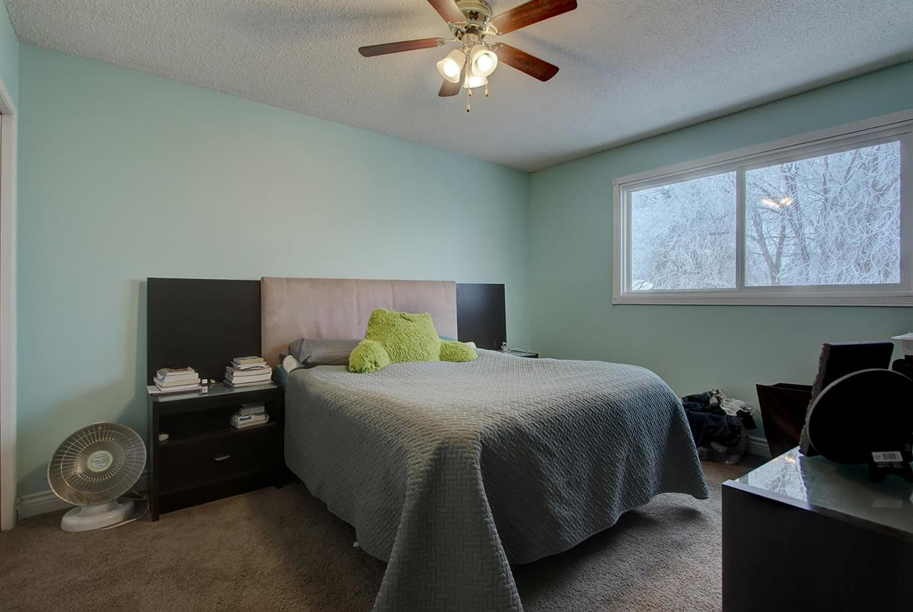 The Master bedroom has space for your King sized bed and a large window looking into your private back yard. Note the huge trees..
