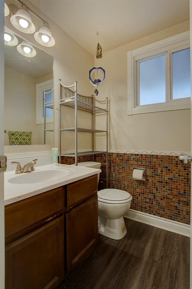 The main bathroom has convenient ceramic tile on the lower wall.