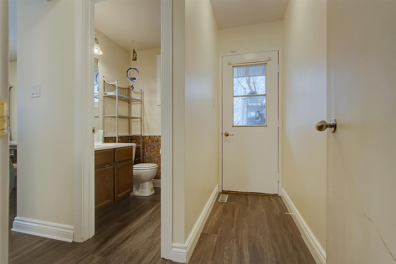 The backdoor has an insert that opens and adds more light and you can see the powder room is a very convenient location.