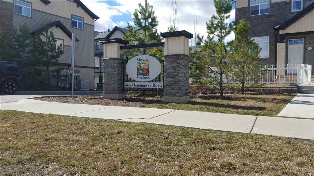 Super nice townhouse style condominium is in a great location in Mosaic Meadows complex.  Enjoy the open main floor that's perfect for year round enjoyment.  Two bedroom, master with 3 piece ensuite and upper floor laundry.  Features full tiled backsplash, hardwood, ceramic tile and carpet through out.  Double attached garage.  Show and sell with confidence.