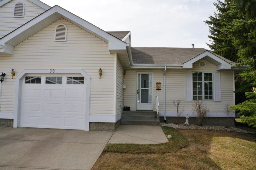 Beautifully maintained end unit bungalow style 50+ half duplex. This unit has one of the largest lots with mature trees and a park like feel. A bare land condo which boasts an open kitchen with an abundance of countertop and cupboard space plus new dishwasher, overlooks the DR with a vaulted ceilings that carry thru to the LR. You'll be impressed by the abundance of natural light from the large windows and the patio doors that lead out to the brand-new south facing deck.  There is main floor laundry with a new washer. A spacious master suite with a two-piece bath.  Also a bright 2nd bdrm plus 4 pce. bath which completes the main floor.  The unfinished basement is just waiting for your personal touch and has loads of storage space!  This complex has a club house/Amenities building where owners can enjoy games and social gatherings as well. A very quiet complex that has all new roofs in 2015. Fabulous location, close to shopping & restaurants.