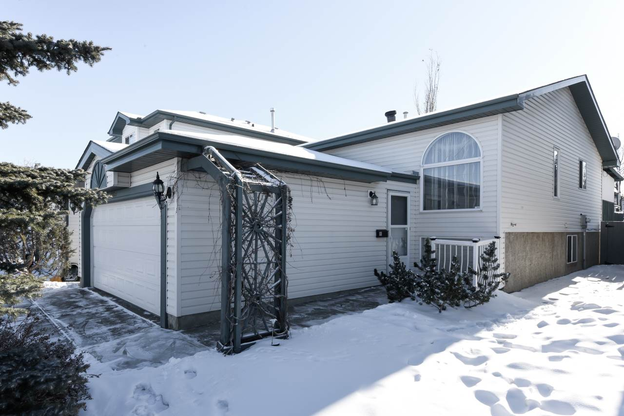 QUICK POSSESSION IN CUMBERLAND.  This well cared for Skyview Bi-Level with double attached garage offers nearly 1,600 sq.ft. of living space!  As you enter you will notice a welcoming and ample living room with gleaming hardwood floors.  Cheerful kitchen provides efficient layout with movable island, bright dining area, and pantry.  The upper level boasts: master retreat with his and hers closets, ample 2nd bedroom, and 4pc bath.  The fully finished basement has a large open flex area with gas fireplace, 3rd bedroom, 3pc bath, and laundry with freezer.  Enjoy your morning coffee on the covered south facing veranda and BBQ's on the generous deck which overlooks the fully fenced and landscaped yard.  Recent upgrades include: newer roof (2014), stove, fridge, and dishwasher.  Steps from Cumberland lake and park!  Well situated near schools, shopping, and public transport.  Quick access to Anthony Henday and other major routes.  MOVE IN READY!