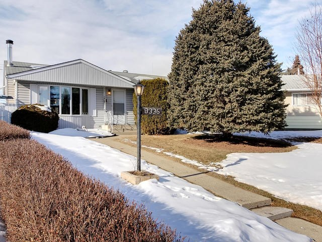 To say this Elmwood 1100 sqft bungalow is clean & well kept would be an understatement. Nestled into a quiet corner on a big pie lot in this west end community, this will impress you. Walking in, to your left the sun streams in through the triple pane bay windows into the large living room. The kitchen, with ample counter space, & attached dining room, you can see yourself starting to plan your family entertaining. Down the hall a 4 piece bathroom, and 3 good sized bedrooms await you. To make you feel even more nostalgic, the basement has retained much of the original luster with a wood burning fireplace in the big family room, 4th bedroom, 3 piece bath and a great sized workshop. Outside the huge yard has seen a soccer game or two, and will again. Do you collect cars? The oversized garage and parking pad will help you to store them. With West Edmonton Mall, several schools & the Misericordia only foot steps away, its time to move to Elmwood!!