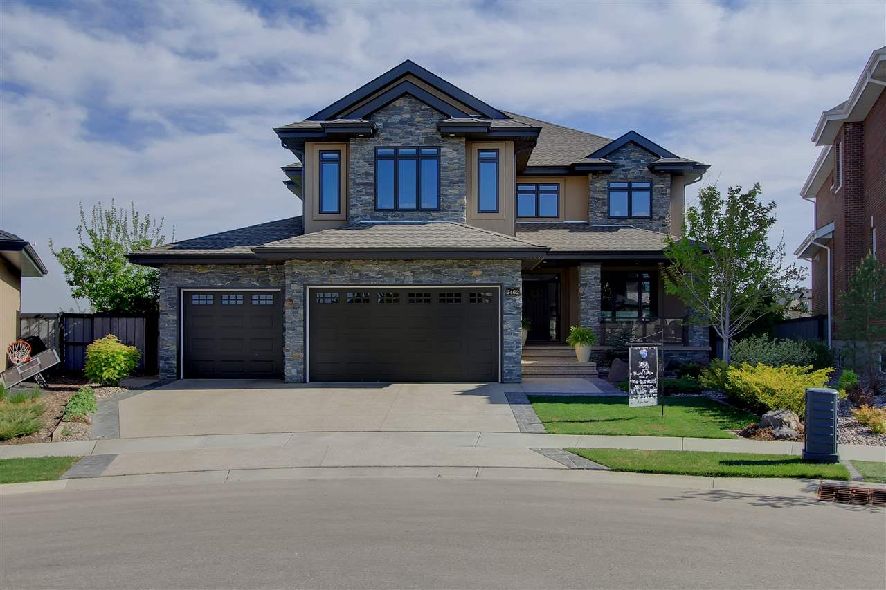 Breathtaking in Magrath Summit! You will be captivated by the features and architecture in this custom built Ace Lang home, nestled on a 10,668sqft pie lot w/$150K of prof. landscaping! This stunning, 2 storey home offers 5000 sqft of  living space.  Entering the foyer you are welcomed by plenty of natural light from cascading, floor to ceiling windows, and an open design showcasing gorgeous hardwood. A gourmet kitchen w/granite island, is fully catered w/built-in S/S appliances, plenty of cabinetry & a walk-in pantry, spacious dinette along w/formal dining room offers a scenic view to walking trails. Relax in the living room w/beautiful stone & mantle gas f/p or retreat to the den. An amazing spiral staircase ascends to the Mstr. Suite w/luxurious ensuite w/spa bath & walk-in closet. The 2nd/3rd bdrms. share an ensuite, and a lg. bonus room. The lower level offers lg. windows, 4th/5th bdrms, family/rec room & bath. An O/S, heated/insulated triple garage has 10'6'' ceiling with hot/cold water.