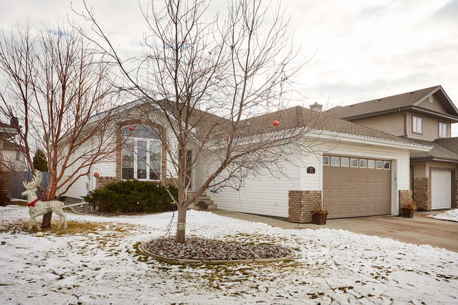 This 1633 sq ft bungalow has 2+2 bedrooms plus a main floor den that could be a 3rd bedroom on the main floor.  Located in a quiet cul de sac close to the walking paths as well as schools, has a great location and a lovely open plan.  The foyer is spacious with a lovely view of your great room that has a ton of natural light as well as vaulted ceilings. The main living area has hardwood flooring. The kitchen is spacious with a walk in pantry, a ton of cabinets and granite counter space.  The eating area will accommodate those special large family dinners.  There is direct access to your large backyard that is well landscaped and has a tiered deck.  All of the bedrooms are generous in size and the master has a large walk in closet and a 4pc ensuite with a 6Ft soaker tub.  The basement is well done with 2 extra large bedrooms with a Jack and Jill 3 pc bath with double shower.  The family room is spacious and has the 2nd gas fireplace.  There also is a games area great for a pool table.