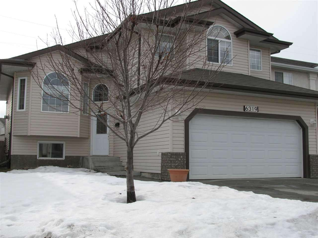 Absolutely stunning Bilevel with 4 bedroom, with over 2500 sq. ft. of developed living space.  A fully finished basement with full bath, spare bedroom with huge closets including laminate flooring. A grand front entrance that opens to the upper and lower levels. Vaulted ceilings throughout main with spacious living room, cozy fireplace, open to the  kitchen with tons of Oak  cabinets! The main floor features gorgeous hardwood & ceramic floors throughout, also includes 2 spacious bedrooms with a full bath. Walk upstairs to your personal oasis to a large master bedroom, walkin closet & a 4Pc ensuite bath with jacuzzi tub! Large windows throughout flood the home with natural light! Outside the 2 tiered deck opens onto a huge yard with tidy tool shed, perfect for the kids and pets. Attached double garage dry walled, insulated and heated, perfect for parking & workshop! Close to all levels of schools, shopping and public transportation.