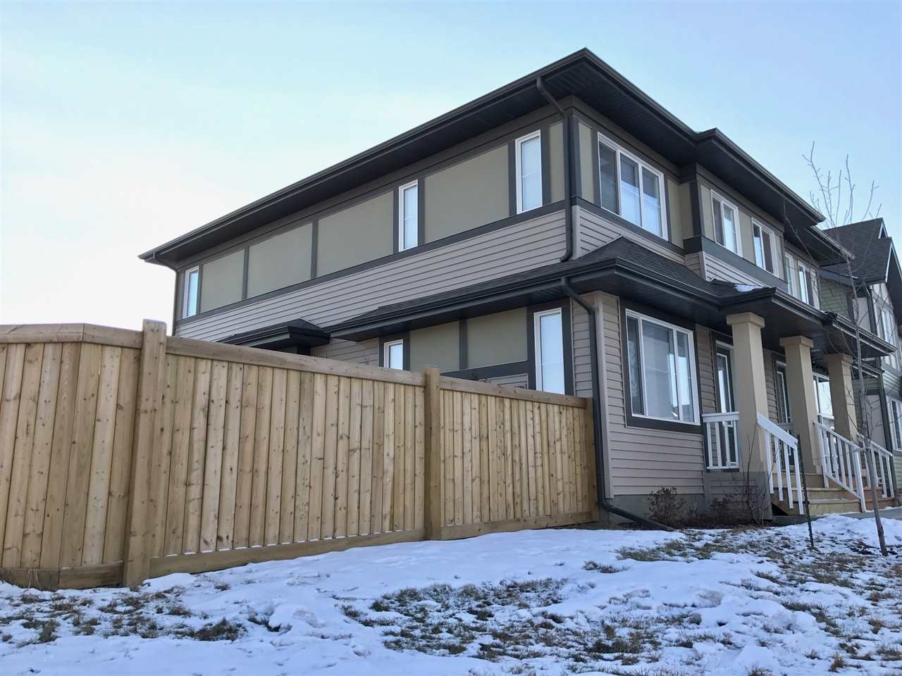 Welcome to a bright 3 BDM 2.5 BTH Brookfield duplex in Paisley with a DBL garage. On a massive corner lot the home has a landscaped, fenced & low-maintenance backyard with a 2-level deck with gas BBQ hookup. The lot is 348sqm across the street from a large green space, with playground & trails nearby. The main floor has a living room at the front of the home & the kitchen features a 9ft long quartz island that seats 6 people. A back dining room overlooks the sunny backyard. The master BDM on the 2nd floor has a spacious ensuite with stand-up shower & ceramic floor tile, large walk-in closet, & room for a king size bed. Bedrooms 2&3 are at the back of the home, beside the 2nd full bathroom. There are 2 linen closets & professional blinds. The full basement is unfinished with washer & dryer. The home is located only a few minutes from the Anthony Henday, Windermere & Magrath/Terwillegar Shopping Centres, a dog park & ravine trails. A grocery store planned within walking distance.