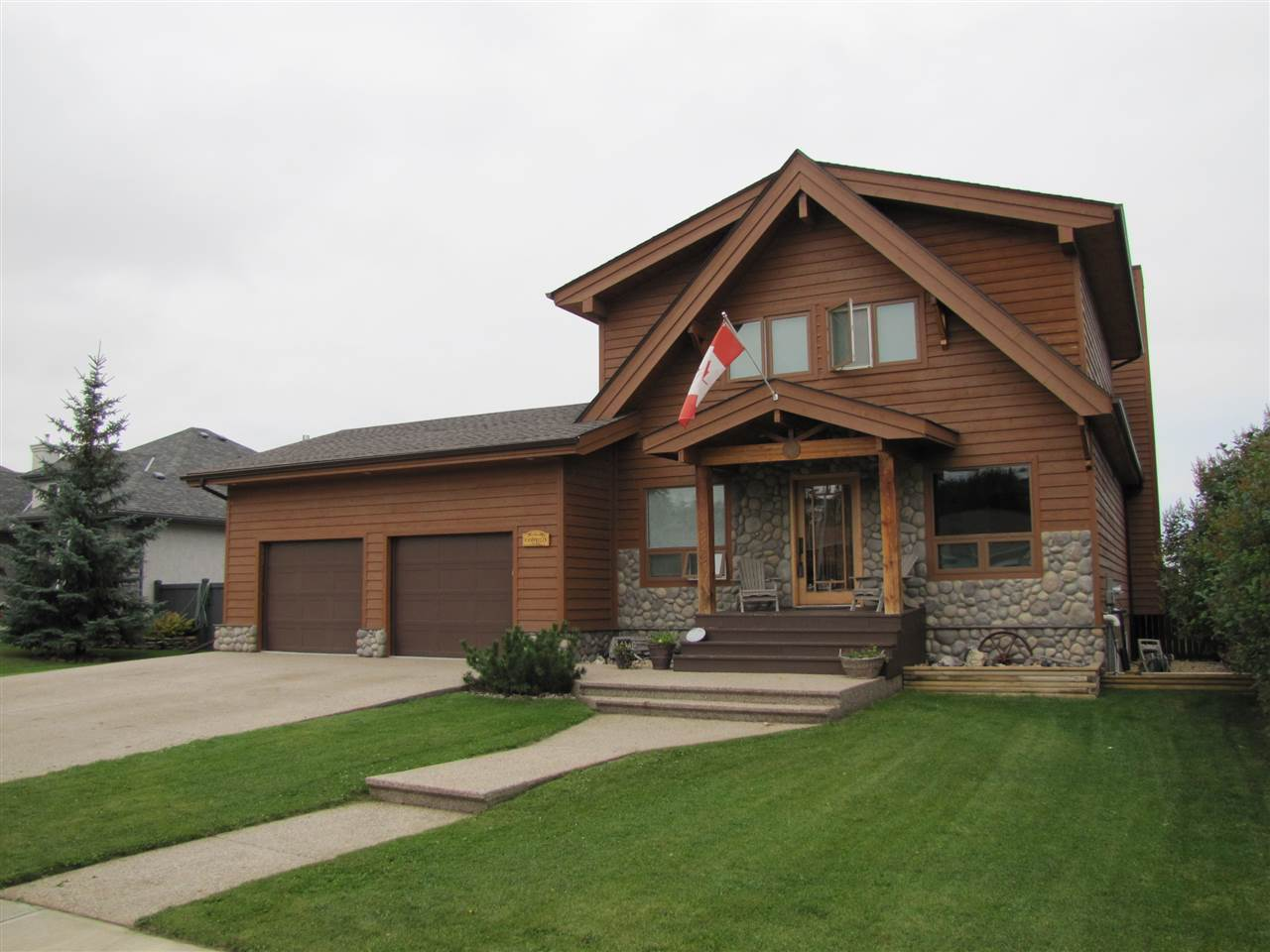 This 2009 built 2200 sq.ft. Architecturally designed open concept Post and Beam Lindal Cedar Home is situated in a desirable south side neighborhood in Vegreville on a 75 x 200 fenced and landscaped estate lot backing onto a natural pond and green space area.   Modern and Contemporary Design with special features throughout including a total of 3 bedrooms and 3 bathrooms, a Gourmet Kitchen, Superior appliances and fixtures, formal dining room and parlor, large deck, great room with rock accent wall, gas fireplace and wall mount TV, custom tile floors, Huge Vaulted Foyer and Loft area.  Basement is fully finished (2011) and contains a family room, 3rd bedroom, 3 pce bath and large storage/utility room.  Large double attached heated garage with exposed aggregate parking pad and walk.  This professional and custom built home has energy efficient in floor heating and passive solar design.  Eco-Designed for its  Environment and Location with Beautiful Views from Every Window.