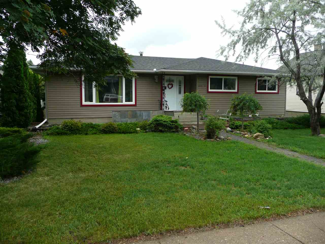 This renovated 3 plus 2 bedroom bungalow is only 5 minutes from downtown and close to all amenities. Recent upgrades in 2013 include new roof, siding, windows, bathrooms, flooring, landscaping and fresh paint. These larger bungalows are rare and having the walkout basement with separate entrance even rarer. There was a suite prior to this owner. Harwood floors on main floor and master bedroom has a 3 piece bath. Property is in excellent condition and move in ready and could be a great spot for a home business with the huge finished basement. There are 2 large bedrooms on lower level and a bonus room where kitchen was located. This lot would can be subdivided for 2 single family homes or an oversized duplex. The lot is 60'x115'. There are many new homes in the area and has great long term potential for an investor with an eye to the future. Large east facing backyard with huge deck and double garage.