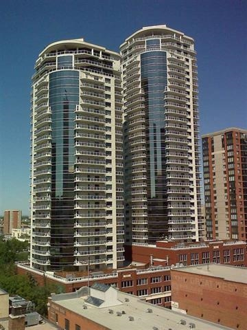 """Icon II is located in the Downtown Arena/Financial/ Warehouse District on the trendy 104th Street. The coveted 1 bedroom """"plan B"""" leaves the kitchen fully open to a space big enough to entertain. This spacious condo offers a bright neutral decor, eating bar, granite counters, stainless steel appliances, wood and ceramic flooring & the added benefit of your own in suite laundry & 1 titled underground parking stall. Large s/w facing picturesque windows in both the living room & bedroom offer tons of natural light with beautiful sun filled views. The roughly 100 sq. ft. balcony can fit a full patio set and a large BBQ with natural gas hookup, and overlooks the nearby park.  Enjoy the River Valley Trails, weekend Farmer?s Market and all the culture and entertainment downtown living has to offer. LRT located across the street with quick access to the U of A, NAIT, Southgate & beyond or walk to McEwan University. A short walk to shopping, theatre, dining & entertainment; perfect location to live, work and play."""