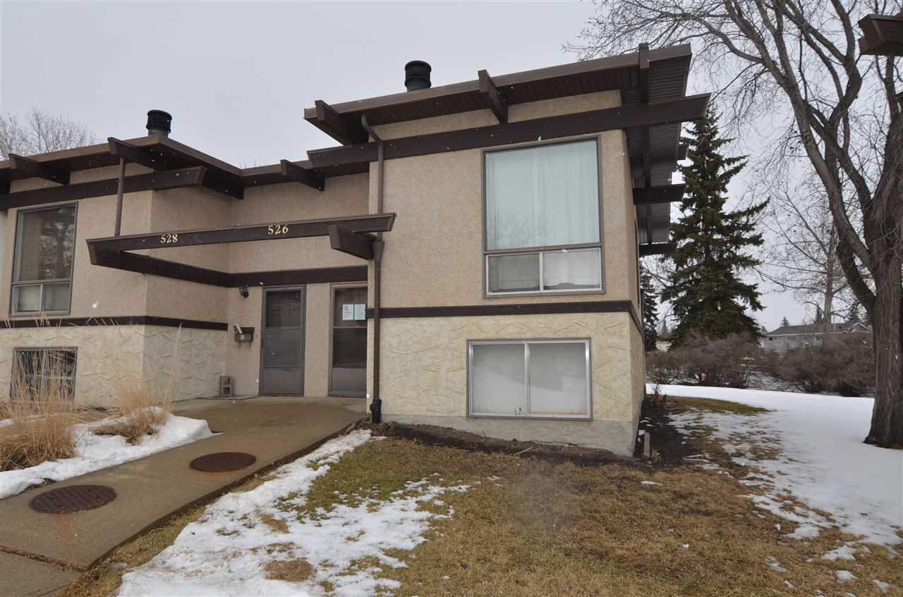Bank Foreclosure. This two bedrooms down, one full bathroom up townhouse condo located in quaint neighbourhood of Lee Ridge.  Wood burning fireplace in the living room and open beam concept as well.