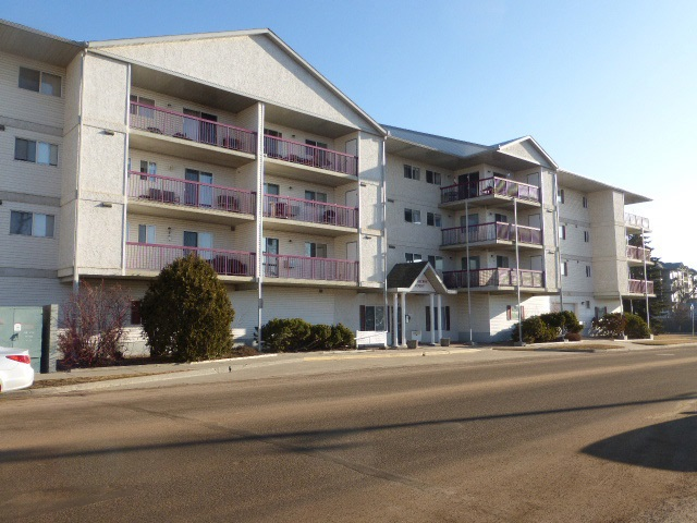 Centrally located in Leduc, this quiet 45+ adult condo features concrete floor construction making it very sound resistance.  Main level heated inside parking means this ?2nd floor? unit is actually on the 3rd level.   Featuring 806 sq. ft., a good size bedroom, den with double French doors, large living room with patio doors to balcony, spacious kitchen boasting loads of white cabinets, four piece bathroom, and laundry room with lots of storage space. Large north facing balcony with storage room.  Amenities include a work shop, exercise area, social room and is across from public transportation and the new library. Condo fees $257.69 per month includes water, sewer, natural gas, heated underground parking.  Parking stall #23. No pets.