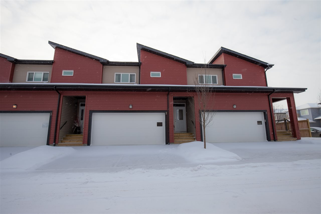BEST VALUE IN NORTH EDMONTON!! AMAZING OPPORTUNITY  Located in desirable Oxford. This BRAND NEW townhouse is loaded with beautiful features, including a dbl attached garage, 1348 sq.ft. of living space which includes 3 bedrooms, 2.5 bathrooms. High end modern finishes throughout! Your new home comes with a Certified New Home Warranty. Upon entering, the spacious tiled foyer is bright and welcoming. The open concept main floor is where you'll find your wonderfully appointed kitchen with plenty of cabinetry, stainless steel appliances, quartz countertops, island with eating bar and a separate eating area. The large living room is bright and spacious. Access to your deck off the kitchen area. Warm, welcoming neutral décor throughout with easy to maintain high-end laminate flooring. Upstairs you'll find the Master bedroom with ensuite, walk-in closet and the 2nd & 3rd bedrooms which have closet organizers. The finishing touch to this home is the double attached garage. Make your dreams a reality!