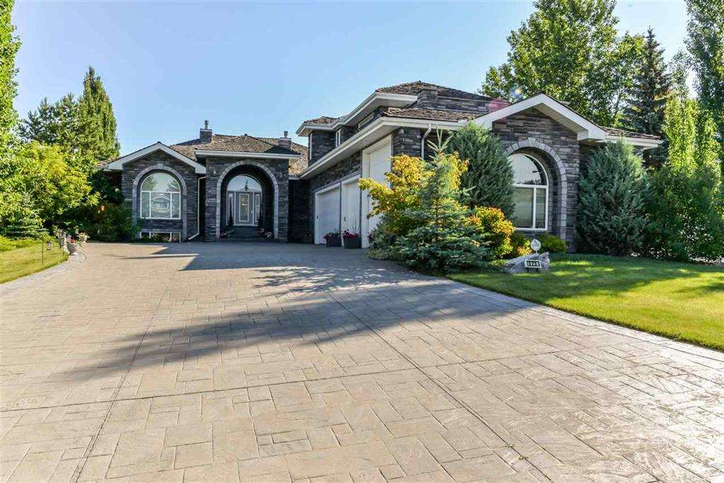 Over 5000 sq/ft of living space in this impressive luxury walkout bungalow in the exclusive Estates of Sherwood Park. Striking entrance and foyer with an unobstructed open concept view through the home to the back yard. A natural light lover's dream! The main floor boasts a Great Room, formal Living Room, enormous chef's kitchen with endless granite counter space, double wall ovens, gas stove, and pullouts on all cabinets. Expansive master bedroom with double sided fireplace, walk through closets, and a spa like en-suite that's to die for.  Large office/den on the main floor.  This home boasts a spacious bedroom over the garage with it's own 4 pce en-suite, walk in closet and sun deck.  2 generous bedrooms on the fully finished lower level, which also includes an additional 5 pce. bath, tv room, games room, and wet bar.    5 car garage with RV parking.  Absolutely striking Platinum Country Stone exterior. Remarkable curb appeal. A large and inviting private yard for entertaining, with a huge deck and tub.