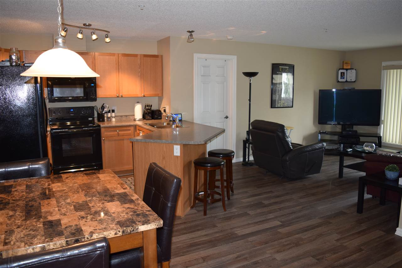South facing and spacious 2 bedroom, 2 bathroom condo in Skyview Landing. Open floor plan, 881 sq ft with new laminate floors and upgraded appliances. Large in suite laundry with ample storage and underground parking # 58 (Legal 305). Seller rents second outdoor stall. Excellent value and walking distance to all amenities.