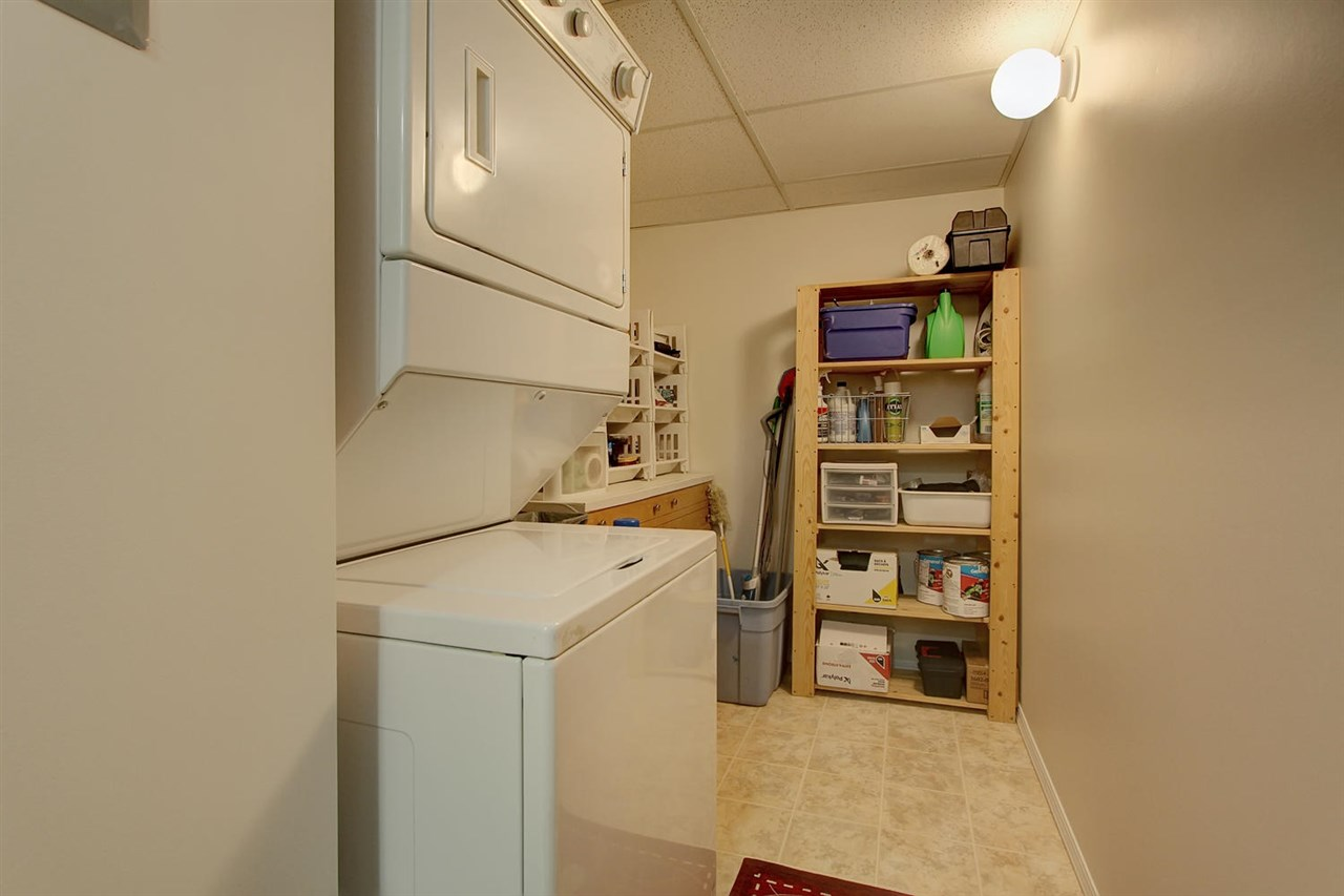 The laundry room has stackable washer and dryer which allows for space for a freezer or shelving as shown.