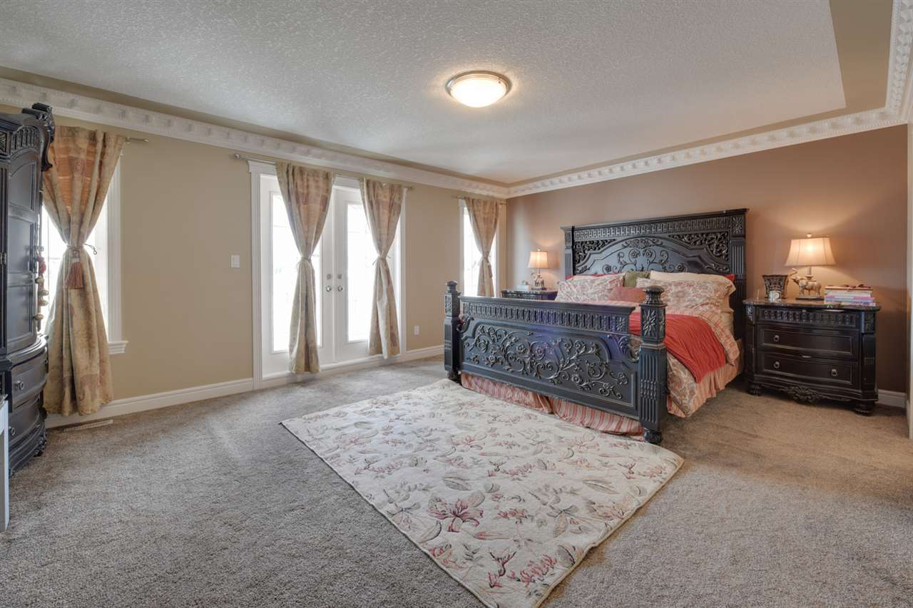 MASTER BEDROOM: Grande master suite with walk in closet, private ensuite & a martini balcony.