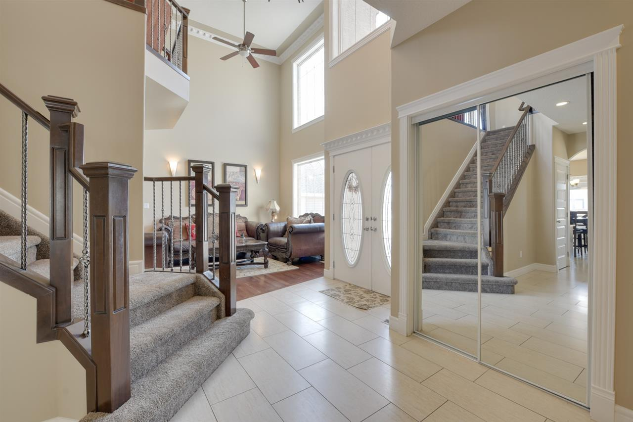 FOYER: 2 storey foyer featuring a formal living room & dining room, main floor den & grande staircase.