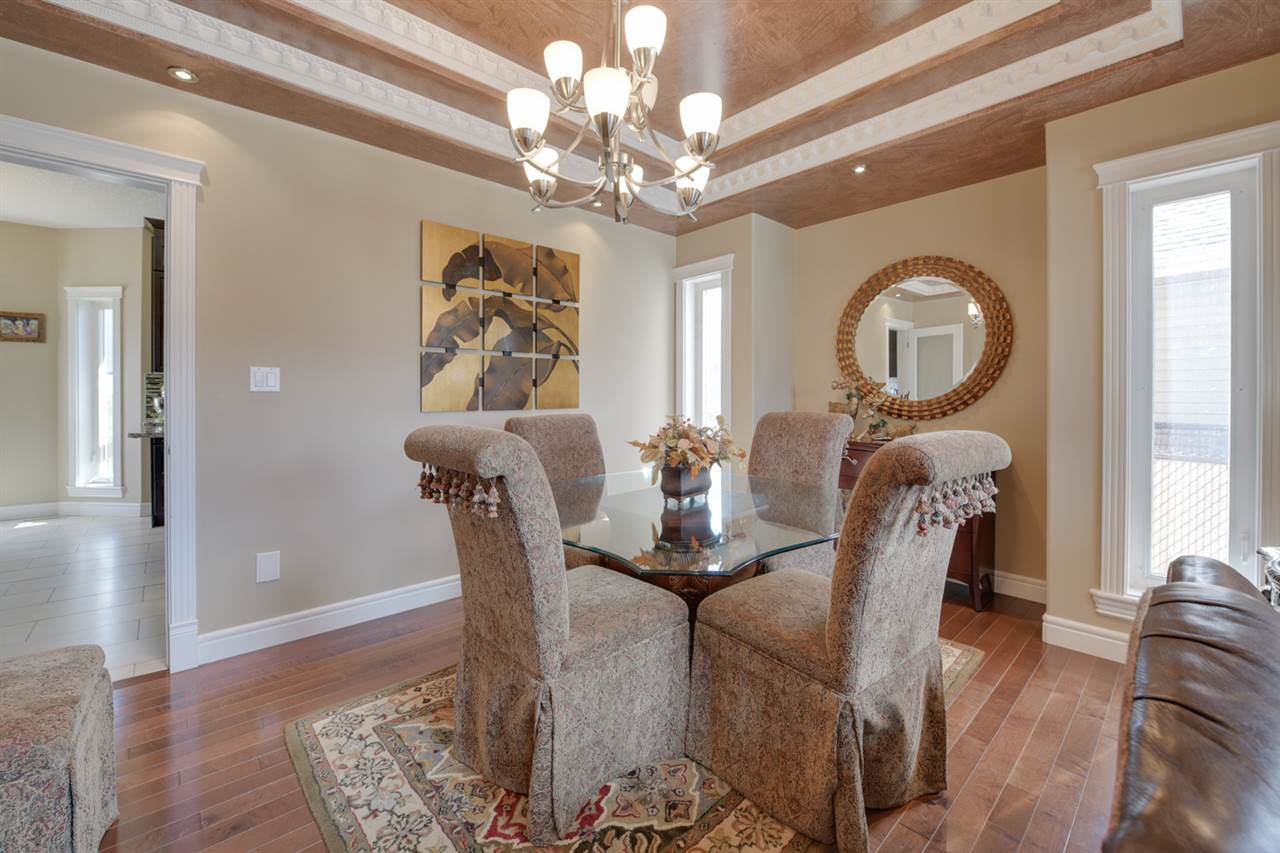 DINING ROOM: Formal dining room with tray ceilings & French doors.