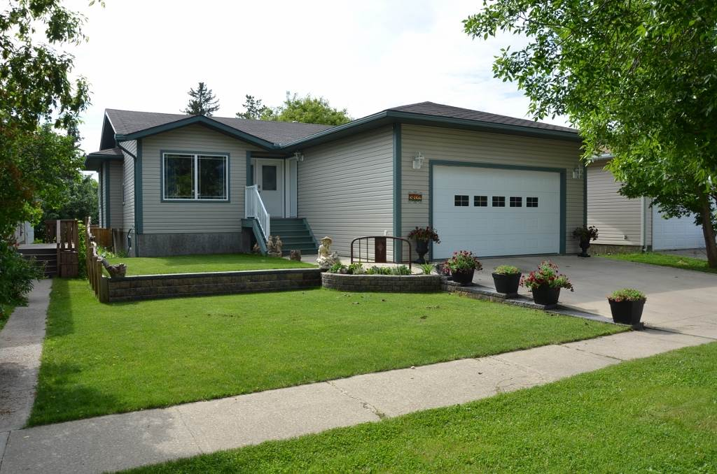 Fantastic Modern property in great location featuring easy accessibility to all down town amenities including schools & shopping by foot or by car. This 2005 1246 sq ft Bungalow w/ fully finished basement has been built w/ excellent features & design including an open, inviting & efficient floor plan including main floor laundry. High vaulted ceilings, large oak kitchen w/ central island,   4 Comfortable bedrooms plus stylish open office area. Tiled jacuzzi main bath, 3pc basement shower & 3pc master shower ensuite. Downstairs you'll find an entertainment room large enough to currently house a full sized pool table, T.V. theater & cozy 3 sided fireplace. Weather sheltered covered rear sitting & BBQ deck overlooking a gorgeously landscaped fenced back yard featuring tiered retaining walls, large yard shed & bonus hot tub. Double car attached garage, is finished & insulated. A must see feel good property for all. Come take your look today.