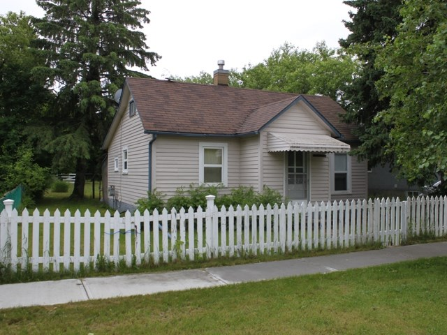 Cozy upgraded Bungalow on Main Street Ryley, just 45 minutes east of Edmonton and Sherwood Park and one hour to the Edmonton International Airport (YEG).  Updates include windows, flooring, bathroom and electrical service (100 AMP). Ideal revenue property, great for those looking to down size.  Top floor has development potential.  50 x 130 lot.  Ryley has an indoor swimming pool, junior/senior high school, community centre, curling rink and more.  Welcome home!