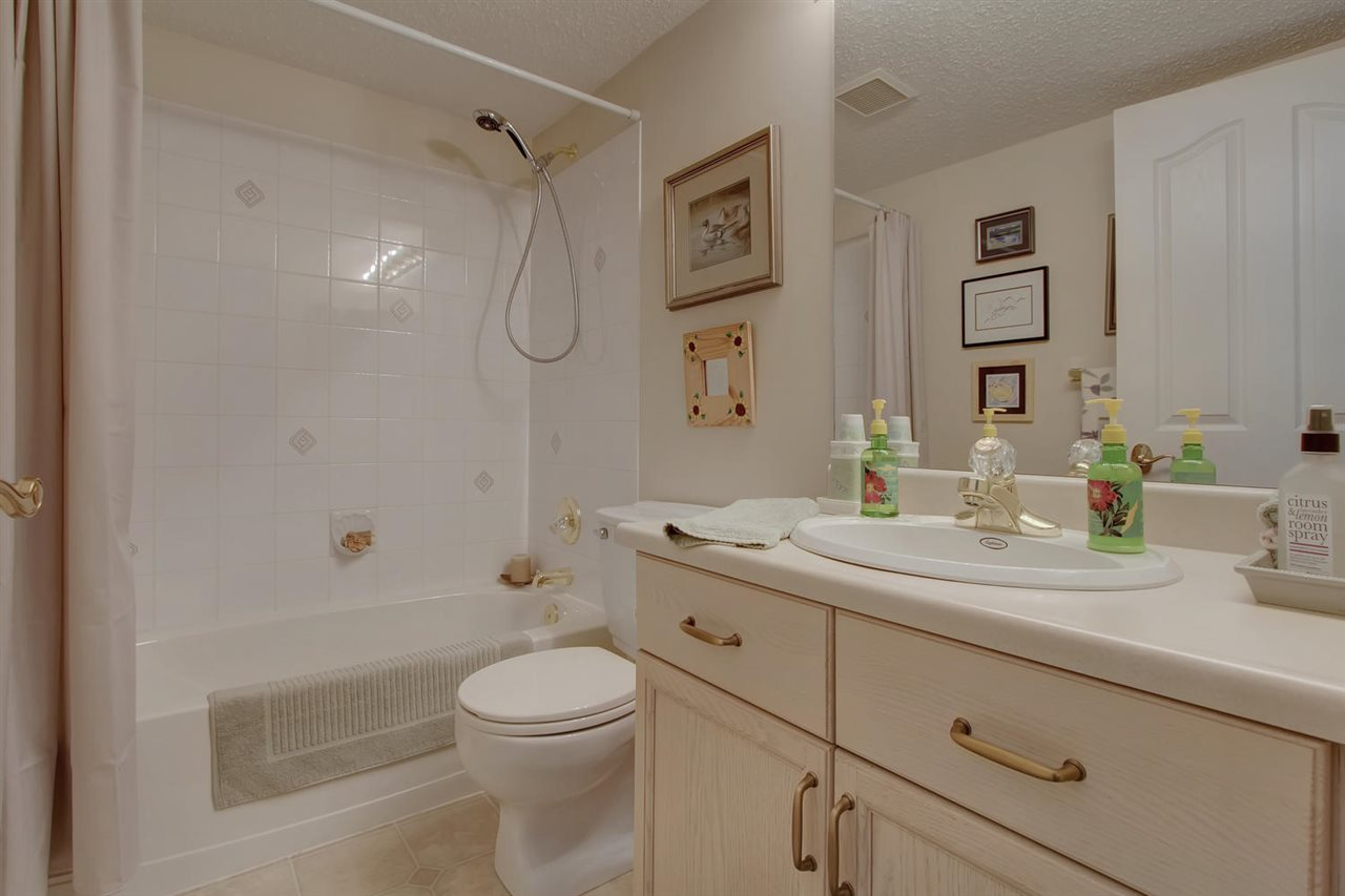 The main bathroom is next to the second bedroom and a ways away from the main living area which is a nice design for privacy.