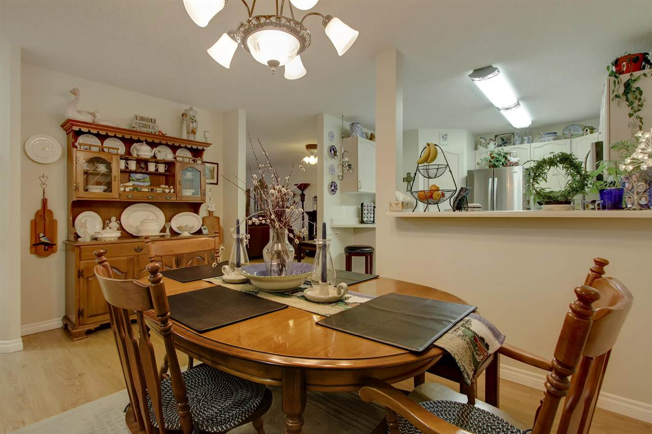 The dining room has space for your china cabinet as you can see, it will fit nicely.