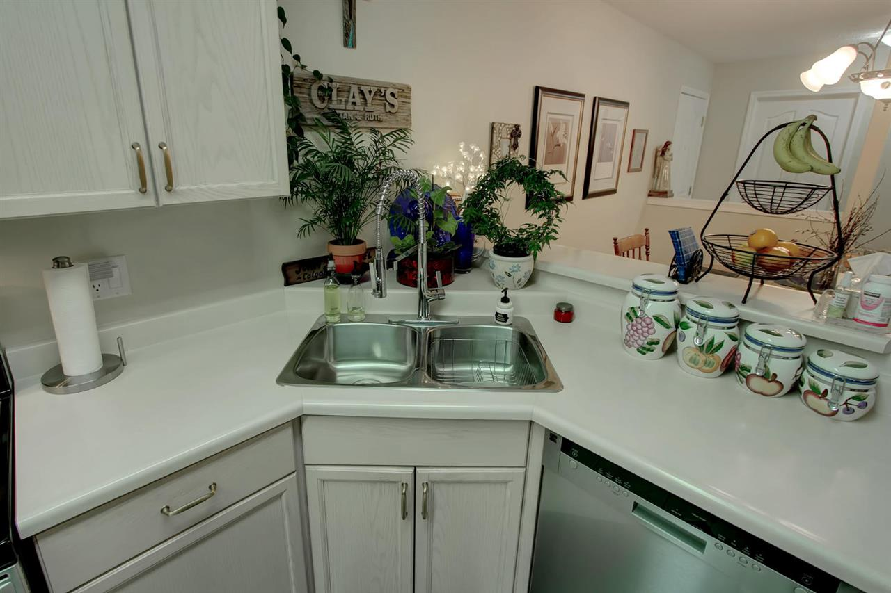 The view from the kitchen sink will let you see into the dining room.