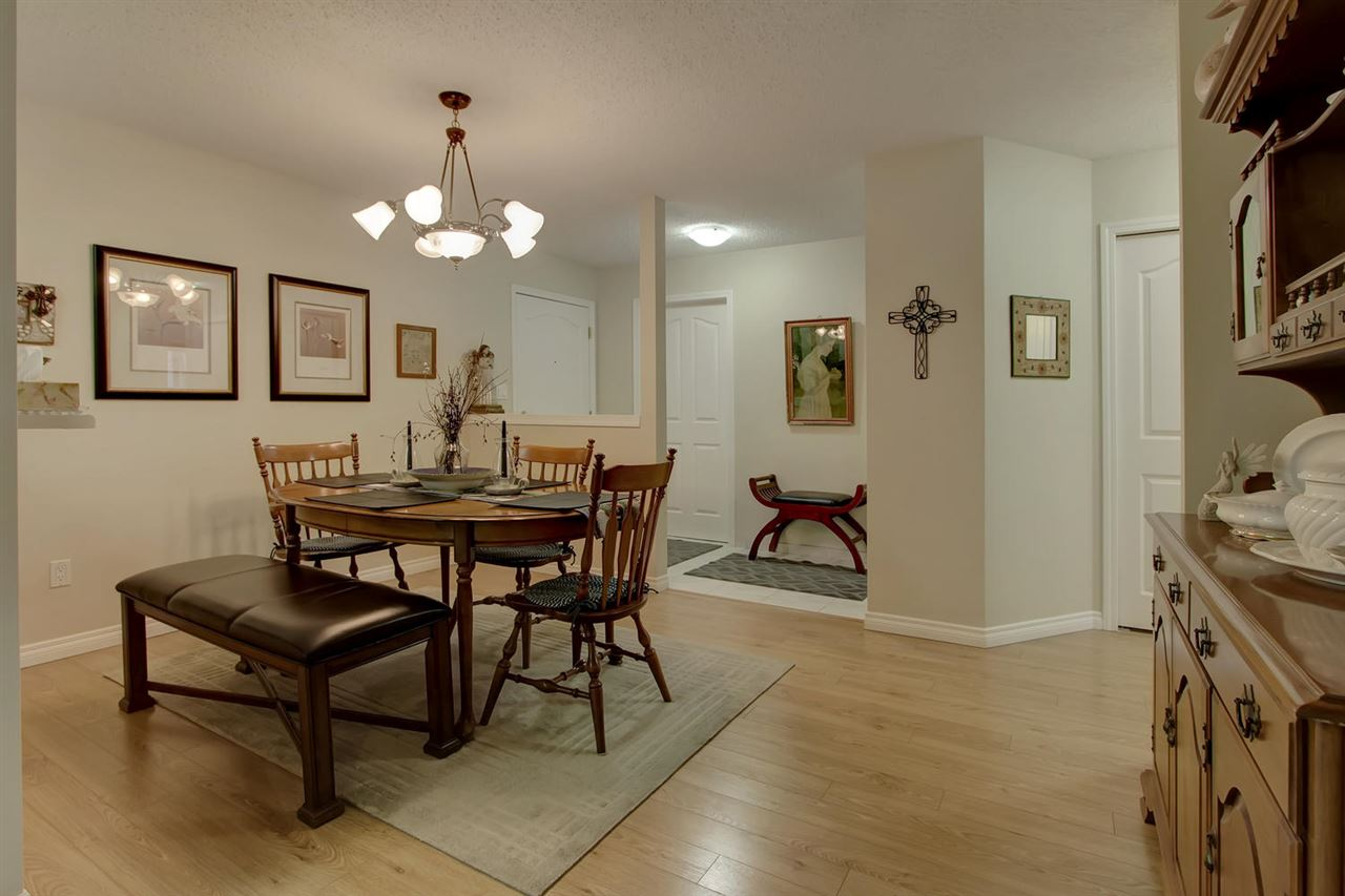 The dining room is large enough to continue hosting family meals and gives you the option to keep up family traditions. The laminate flooring makes it easy to clean up the occasional oops.