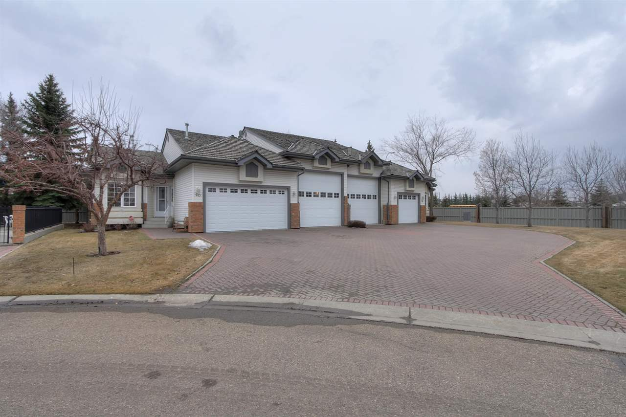 THIS ONE OF A KIND 45+Jewel Box Bungalow for the Mrs., with double attached garage plus a 14 x 38.5 ft. heated RV/Workshop garage for Hubby c/w 14x10 Mezzanine. Extras in the garages include sani-dump, hot/cold water, floor drains, cabinets, 30 amp service, 30,000 btu furnace, sensor activated carbon monoxide exhaust plus more. This home has been completely refinished with high quality finishes that include a new kitchen, granite countertops, 3 new bathrooms, vinyl plank flooring, California knockdown ceilings, hand built stone gas fireplace, all LED lighting, Kitchen Aid S.S. appliances and more. Lower level has similar square footage with 3 storage areas, family room, guest room plus bathroom w/steam shower. Lower level has spray foam insulation, high efficiency furnace, and water tank. Sprinkler system outside. Quick access to Anthony Henday, 10 min. to the Airport, 5 min to LRT and walking trails and public transportation are  close by.  The 1800 ft2 club house has kitchen, lounge and billiards.