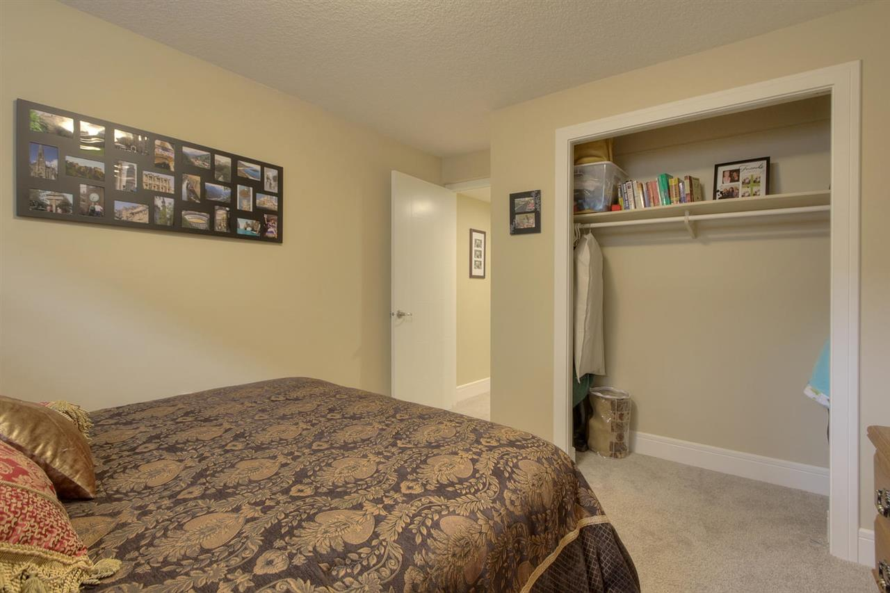 The third bedroom downstairs is a great location for guests. The bathroom is right across the hall.