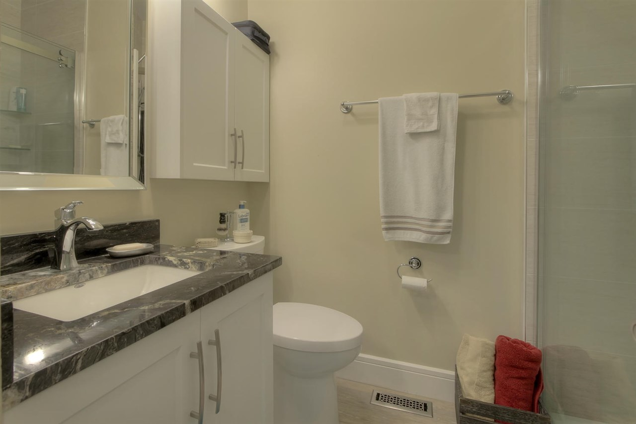 The main bathroom upstairs has an enlarged walk in shower.The granite and other features make this a spa like bathroom.