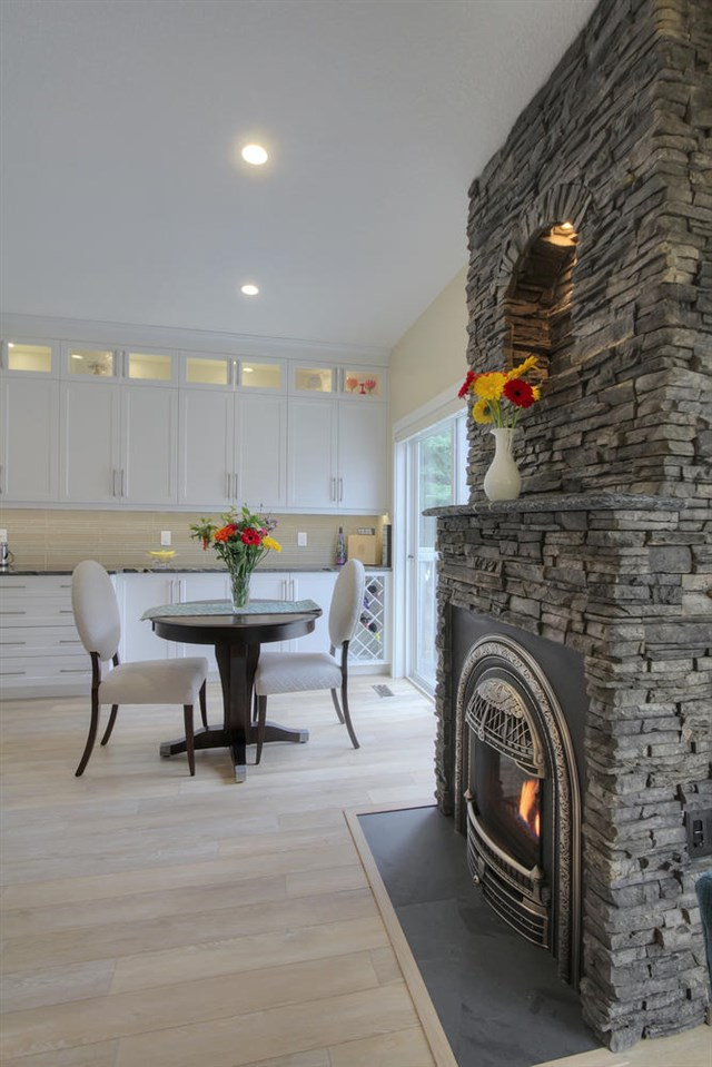The custom fireplace is quite unusual and is run by a remote control. Note the perfect space to place something special. A photo of your grand kids would look great here... or a special pet.