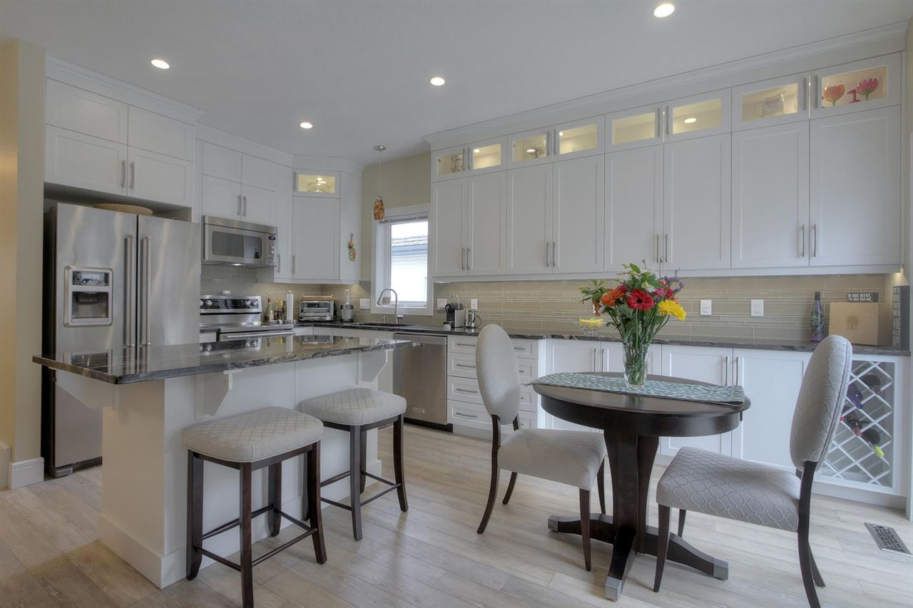 This incredible kitchen will please your every need and probably all your wants also. Check out all the many details that are over the top from amount of cabinets, choice of granite, backsplash, design, high end appliances and more.