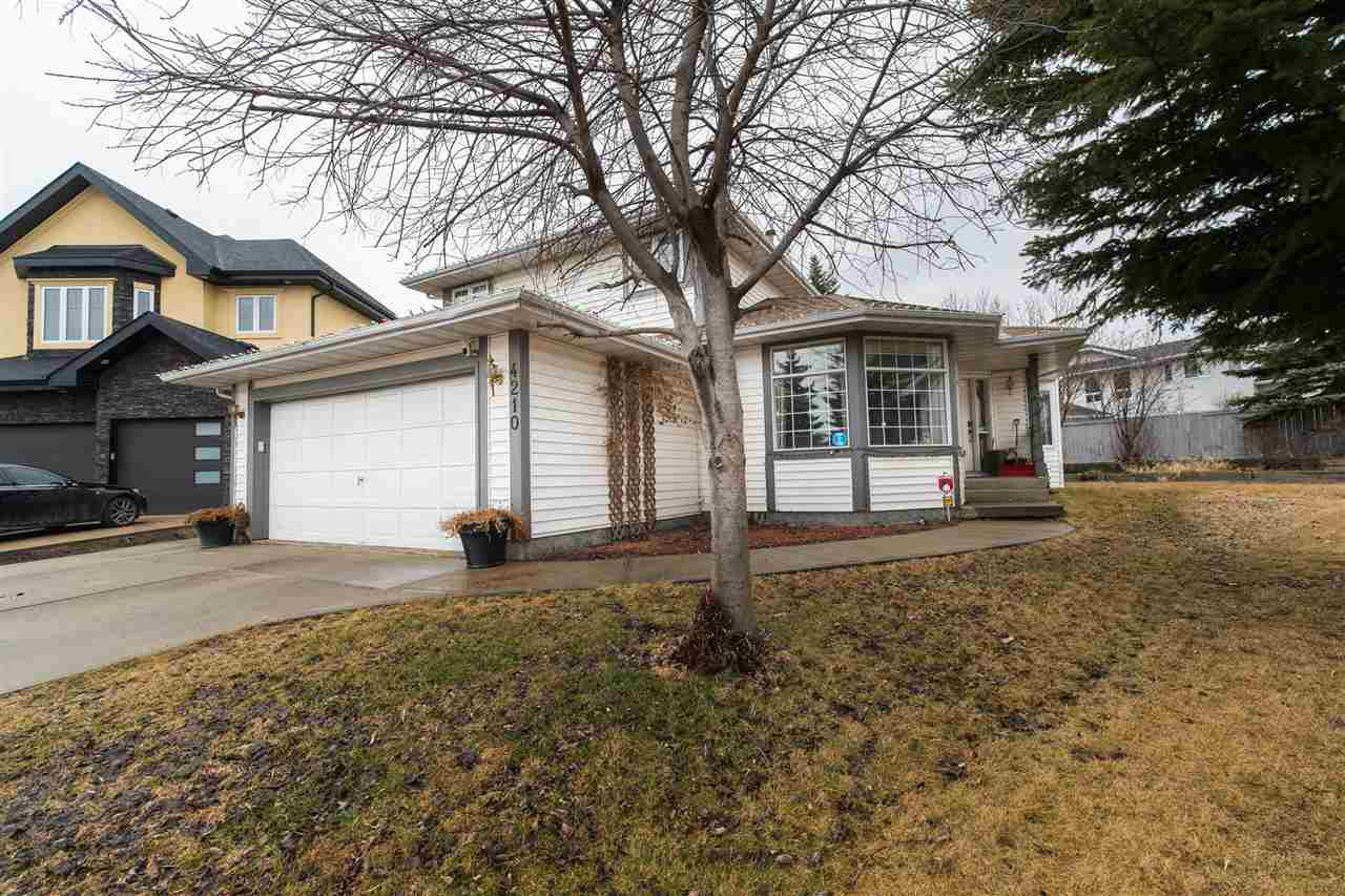 The ravine is calling!! Enjoy nature at its best, with the tranquil ravine trail system right at your doorstep. This updated 2 storey features a fantastic family friendly floor plan. 3 good sized top floor bedrooms, including a grand master boasting a full 4 piece ensuite, plus another 4 piece bathroom for the second and third bedrooms to share. There is a very handy 4th bedroom/den located on the main floor. Flanked by a completely renovated 3 piece bathroom great for guests or elderly family members. Updates include Brazilian hardwood floors, newer paint, light fixtures, carpet and 5 year old shingles make this a move in ready home. All of this located on a massive pie shaped lot in a safe cul-de-sac. Close to Whitemud access, golfing, walking distance to school and close to all major amenities.