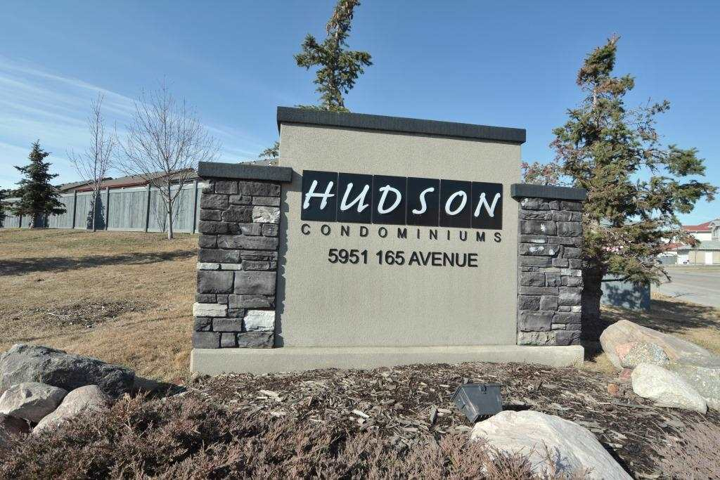This fantastic 2 bedroom, 2 bathroom, 2 parking stall, PET and FAMILY friendly main floor condo unit is located in the well maintained and desirable building of Hudson Condominiums.  Located in the heart of Hudson, minutes to the Anthony Henday, shopping, schools and parks, this is a great location for a first-time buyer, anyone looking for a maintenance free lifestyle, or as an investment property. The unit features many upgrades including laminate flooring, new carpets and baseboards as well as new lighting.  The open concept living/dining/kitchen features is a great layout for entertaining friends.  The kitchen has dark cabinetry, black appliances, as well as a peninsula eat-up island.  There is plenty of space for a dining room table.  The living room features sliding patio doors to the balcony.  There are 2 bedrooms in the unit, as well as a large laundry room with extra storage space. The master has a walkin closet as well as a full ensuite.  And the second bedroom has a full bathroom beside it.