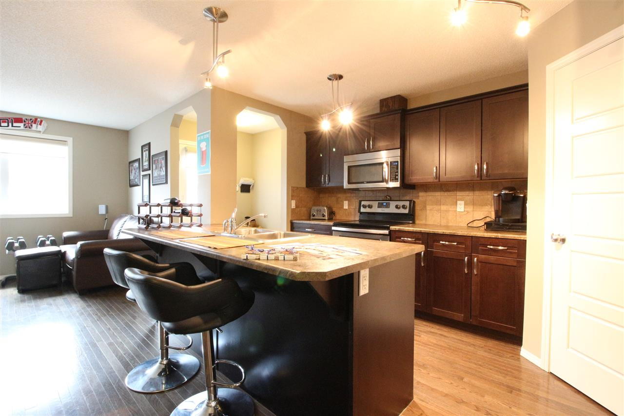 Everything you need just minutes away! This 1400+ sq ft townhome is located on the east side and close to Century Crossing and provides fantastic access to highway 16A! Inside, the main floor is full of space with its two living rooms, spacious open concept kitchen with tons of counter space, and its generous sized living area. The main floor features hardwood flooring, corner pantry, stainless steel appliances, and a bright south facing big window to let the sun shine in! Upstairs you will enjoy three bedrooms and two full bathrooms including your master en-suite! You'll also enjoy the convenience of having your laundry room on this level as well! Outside is the low-maintenance lifestyle you've been waiting for in this fully fenced backyard that is great for entertaining! The detached garage provides plenty of space to keep the snow off in the winter! All of this and more could be yours!