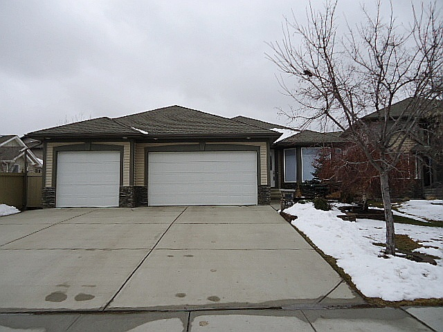 Stunning Salvi-built bung in prestigious neighbourhood of The Ridge. Huge south backing lot almost 1/3 acre in size. 1645 sq ft with f-fin bsmt. 3+2 bds & 3 full baths. Lrg flex room at entry with floor to ceiling bay windows. Gourmet kitchen with massive island, granite counters, SS appls (including 5 burner gas stove, built-in; oven, warmer & microwave), corner pantry,& several banks of drawers. Corner gas fp in GR. Sunny nook opens to partially covered maintenance free composite deck. MF laundry. Large MB with luxurious swirlpool ensuite. FR is wired for 7.1 surround & projector & features convenient wet bar. Huge RR & exercise room finish the lower level. Extras include hardwood, heated ceramic tile in KT & ensuite, in-ceiling spks in ensuite & Kt & great rm, in-floor heating down, underground sprinklers, CAT 5 throughout, & in wall HDMI from source. Heated triple att garage has 26' drive-through bay, hot & cold water & floor drain. Beautiful yard with numerous fruit trees & firepit. Playcenter stays!
