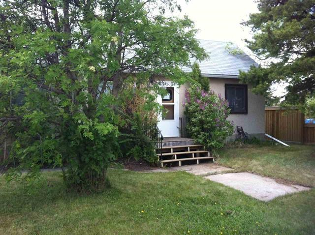 GREAT STARTER HOME!!  or  another revenue property?  2 bedrooms on main level with large country kitchen and east facing living room. 4 pc. bathroom and laundry in the porch. West facing covered porch with an enormous back yard with back lane access.