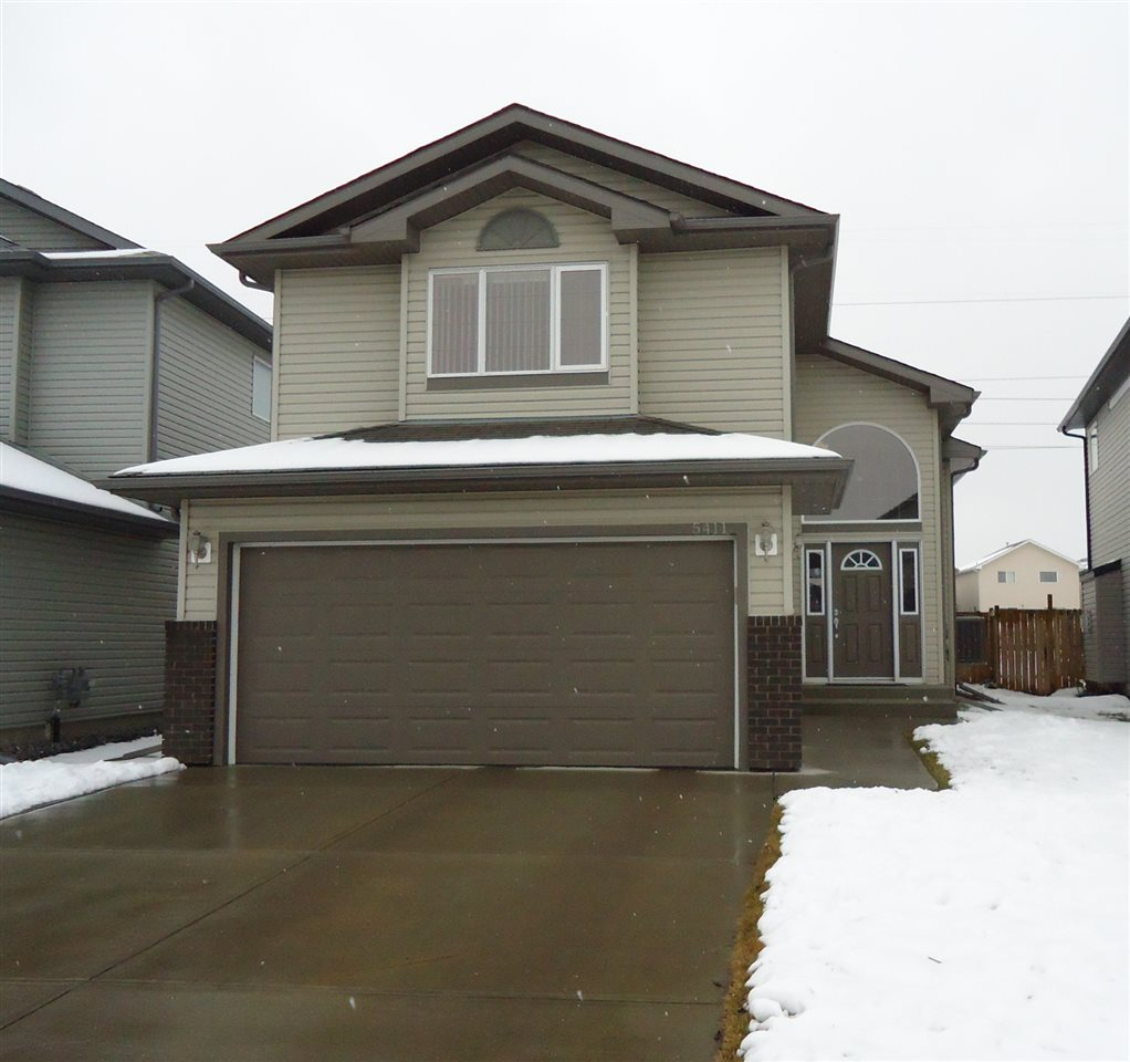 BEAUTIFUL BI-LEVEL BACKING ONTO WALKING PATH!  This Reid Built home is in immaculate condition, everything from the large and bright entrance to the spacious living room with gas fireplace and vaulted ceilings. The open concept kitchen features a large island with eating counter, stainless steel appliances and a pantry for extra storage.  Through the dining area is a patio door to the deck, perfect for all your summer gatherings and overlooking your generous sized yard.  Also on the main floor is a full bathroom and a bedroom.  Up a few stairs is the massive master bedroom with walk-in closet and full ensuite.  The basement is unfinished, allowing you to create the space that would fit your needs best.  Room for two more bedrooms, if needed, and roughed-in for a bathroom.  This home also has a 19'x21' attached garage and is fully equipped with central air conditioning.  Close to schools and shopping and easy access to the Anthony Henday.