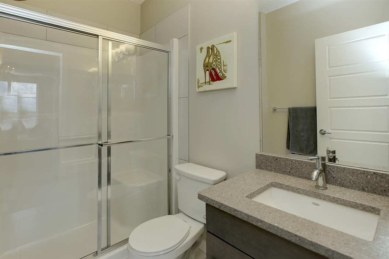 The other master bedroom has the quartz counter top and a nice double walk in shower with a seat.