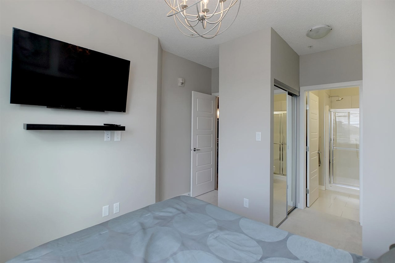 The view of the master bedroom shows another flat screen tv that is available in the turn key option.