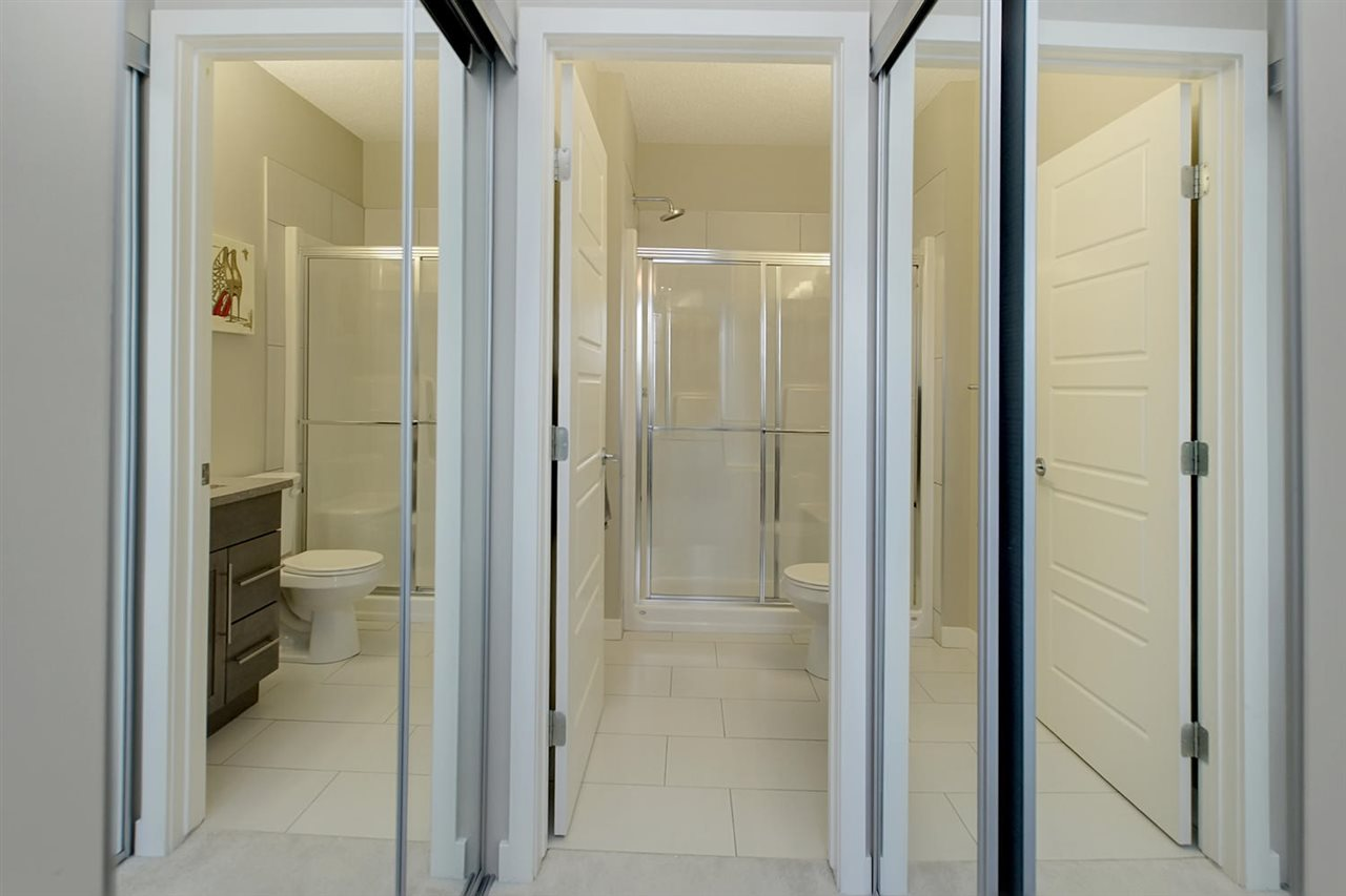 Double closets with mirror sliding doors appear to open up the space leading to the en suite bathroom in the master. They will easily hold all your clothes.