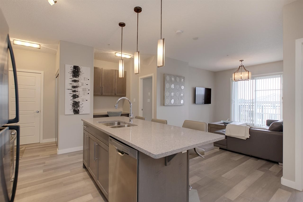 See how nicely the flow goes from kitchen to living space due to the consistent modern laminate flooring.