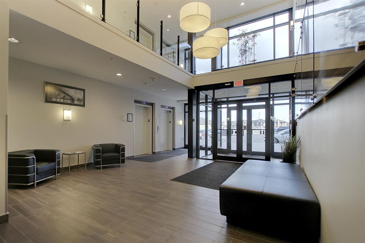 The two storey entrance way is very welcoming. Both elevators are in this handy location.