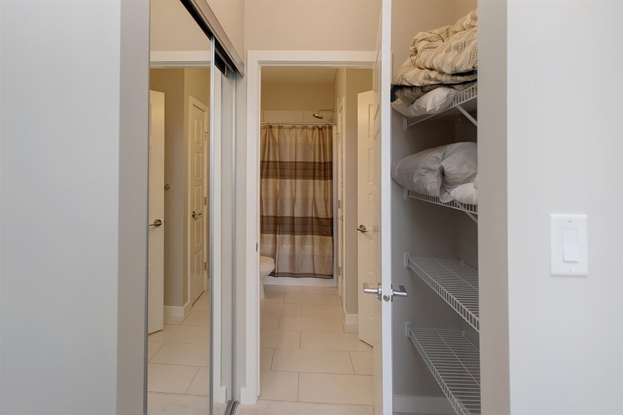 The closets in the second master bedroom have closet on one side and general shelving for storage on the other side.