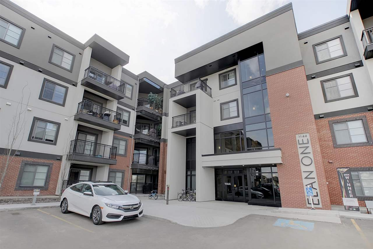 The main door is at the centre of the L shaped complex. You will find plenty of visitor parking in addition to your own underground heated parking stall.